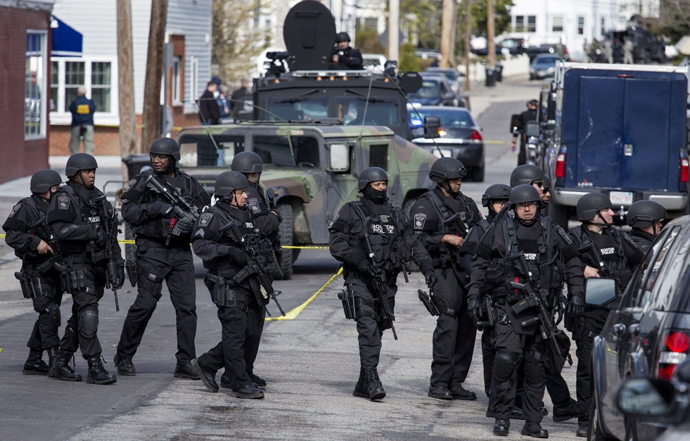 Heavily armed police continue to patrol the neighborhoods of Watertown, Mass.